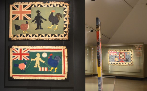 Fante asafo flags from Ghana, two on display in a museum, chickens and roosters,