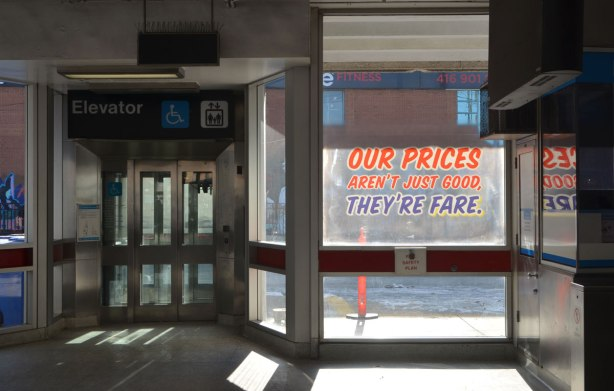 sign maker from Honest Eds store has redone some of the signs in Bathurst subway station plus, he has added some Honest Ed type promo signs around the station - on the window of the station, Our prices aren't always good but they're fare