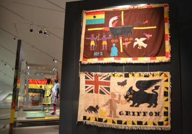 Fante asafo flags from Ghana, two on display in a museum, griffons