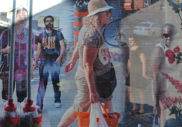 part of a mural in Honest Eds Alley by Matthew Monteith showing people walking past the windows of Honest Ed's store, large scale photo
