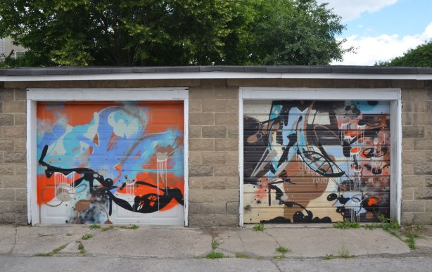 Pascal Paquette abstract street art on two adjacent garage door in a lane, by Pascal Paquette, swirls of colour
