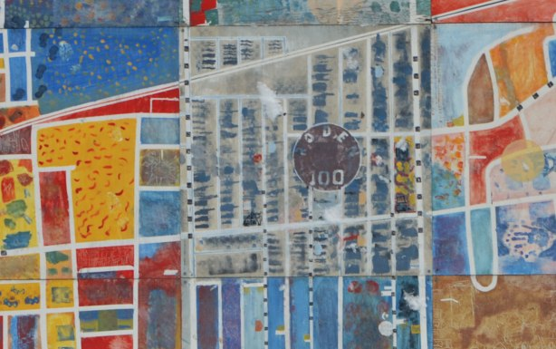close up of the center of a mural on a conrete wall in a schoolyard that is a map of the area with the school in the center, colourful, about 8 feet high and twelve feet wide.