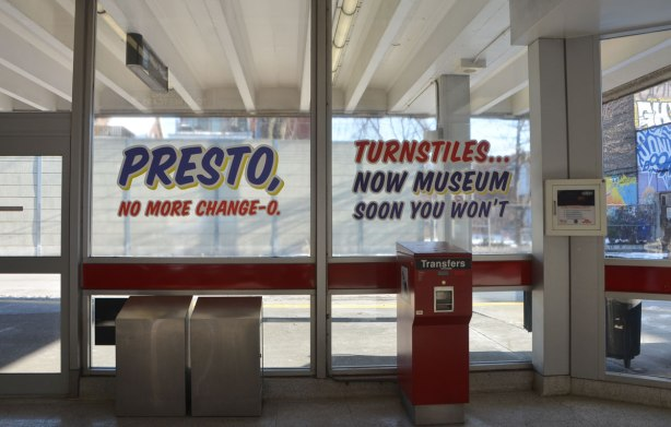 sign maker from Honest Eds store has redone some of the signs in Bathurst subway station plus, he has added some Honest Ed type promo signs around the station - on the window of the station are two signs, one says Presto no more change-o and the other says Turnstiles now museum soon you won't