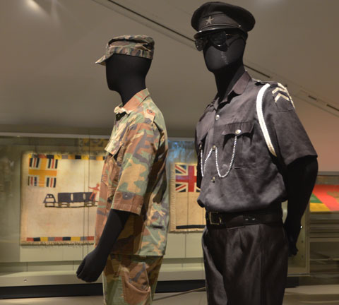 two mannequins in military uniforms as part of a museum exhibit at ROM