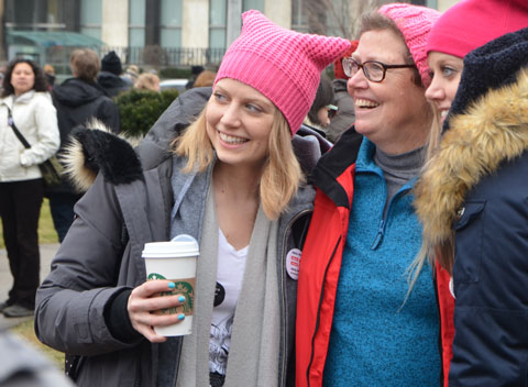 Womens March, Toronto - women smiling and posing for the camera, wearing pink pussy hats