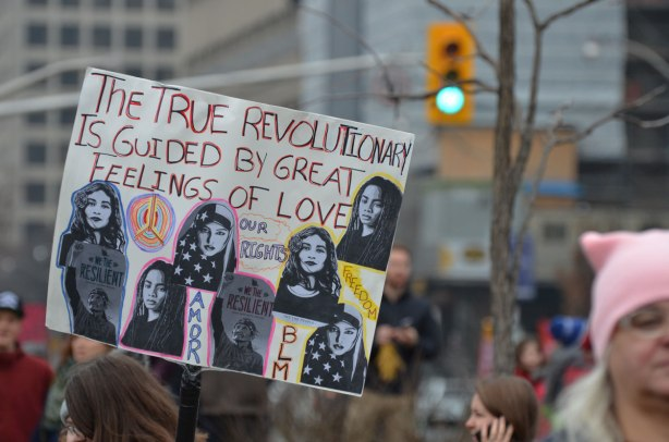 a sign at Womens March in Toronto that says The true revolutionary is guided by great feelings of love,
