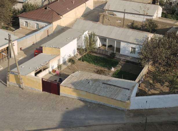 looking down into a courtyard of a residence in Nurata Uzbekistan, looking from the top of a hill