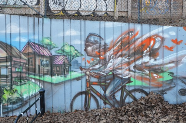 part of a larger mural by elicser in Monarch Park - a cyclist is going fast as he goes downhill