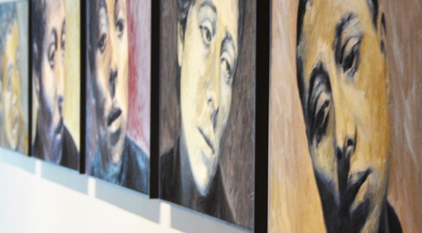 a series of 5 women's faces hung in a row on the art gallery wall, paintings by Will Gorlitz
