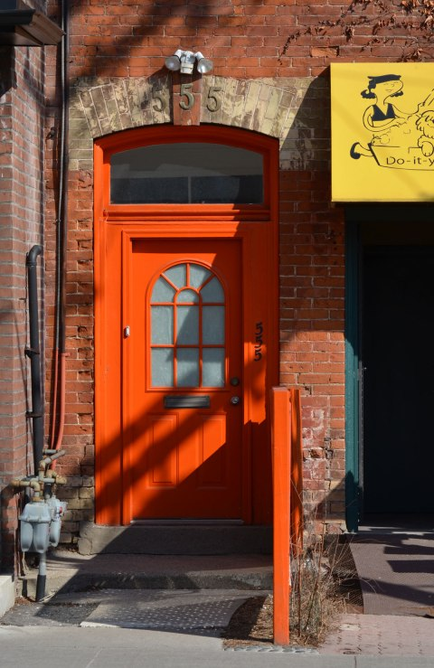a very bright orange front door.