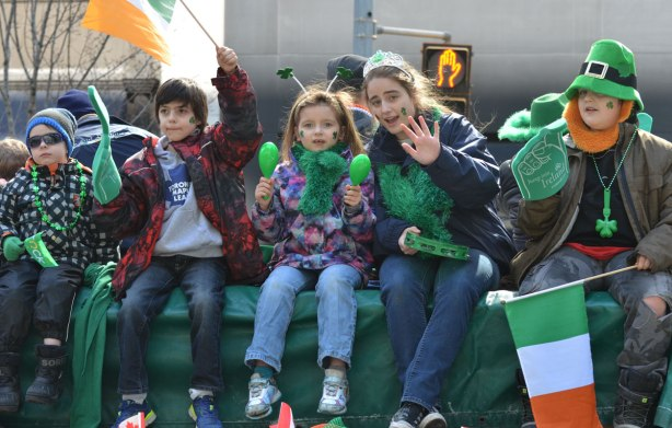five kids sitting on a float in the St. Patricks day parade