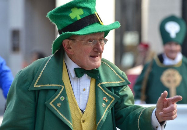 an older man in green Irish tophat and green coat and green bowtie