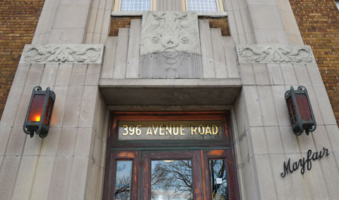 entrance to the mayfair apartments. 396 Avenue Road, stone work and old light fixtures