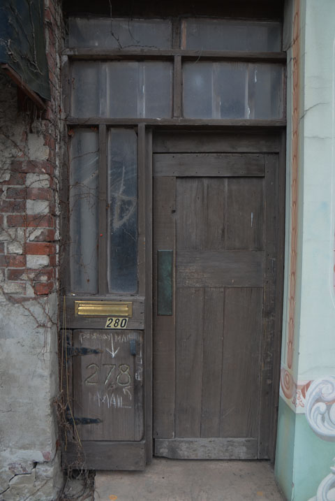 old wood door with mailbox and number 280