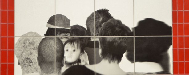 close up of black and white photo of the back of peoples heads, one child's face turns to the camera and is slightly out of focus, Passing by Sylvie Belanger at Bessarion subway station