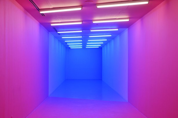 a hallway is lit in pink and blue lighting, covers all walls and ceiling too