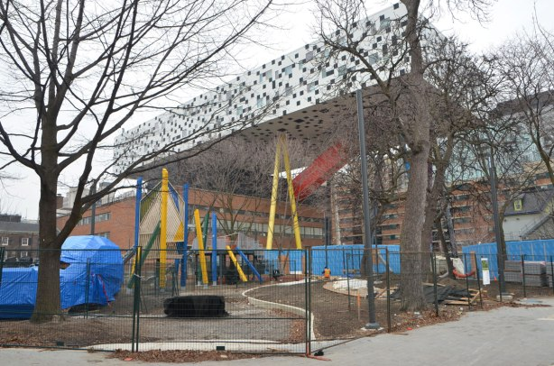 new playground in Grange Park with the box on pencil structure of OCAD behind it.