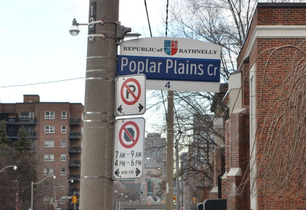 Toronto street sign that says Poplar Plains Cr and also says Republic of Rathnelly