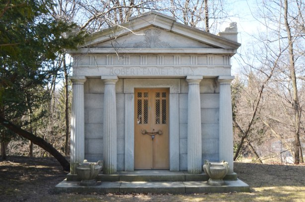small building in cemetery with words Robert Emmet Kelly carved in stone across the top of the door