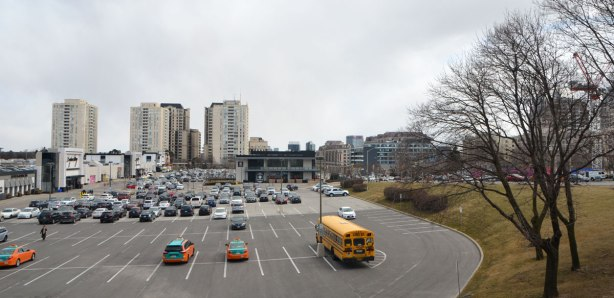 parking lot of a mall, Bayview village with surrounding buildings in the background.