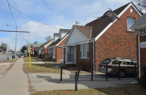 a few small brick houses on the south side of Sheppard Ave