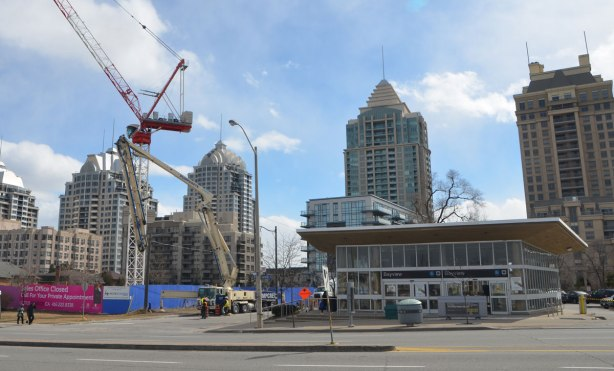 south entrance to Bayview subway station with tall residential buildings behind and a construction site beside