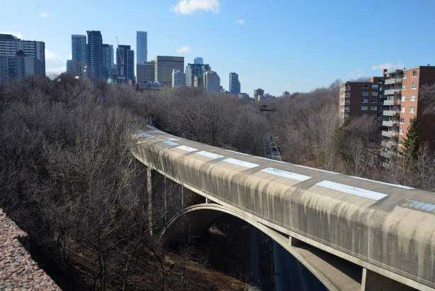 Downtown Toronto is in the distance. The subway tunnel between Sherbourne and Castle Frank stations is in the foreground. It's really a covered bridge as it passes over Rosedale Valley Road.