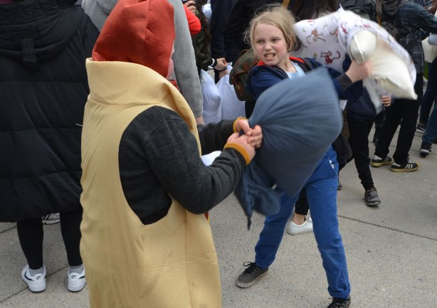 people, pillow fight, Nathan Phillips Square, a girl and a boy wearing a hot dog costume