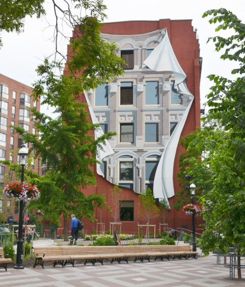 mural of windows and facadde on the back of the flatiron building with the redesigned Berczy park planting and benched in front of it
