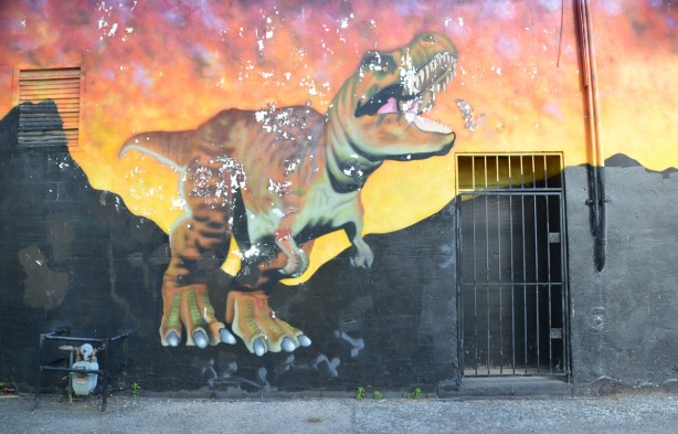 part of a mural with a dinosaur