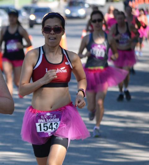 women in pink tutus running in a half marathon