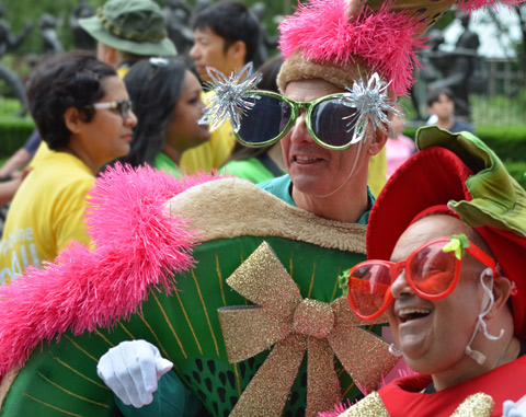 two men in fruit costumes as well as large oversized glasses