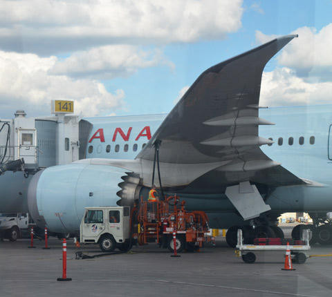 a large Air Canada plane being refueled