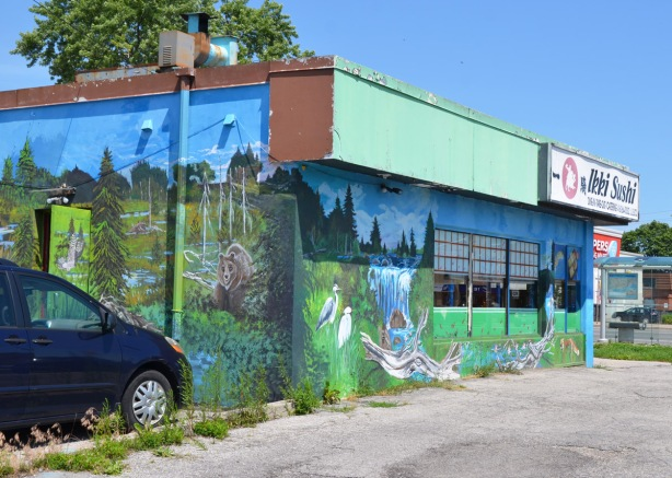 Ikki Sushi restaurant covered with a mural with scenes of Canadian flora and fauna,