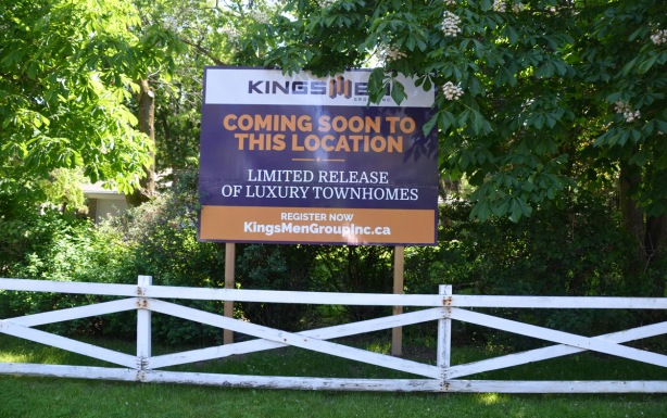 sign advertising new townhouse devlopment by kingsmen Group inc.
