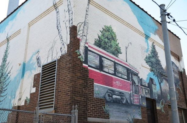 a mural of a ttc streetcar and a heron