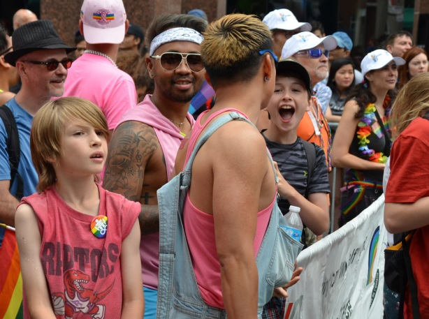 a group of boys and young men at the start of the pride parade