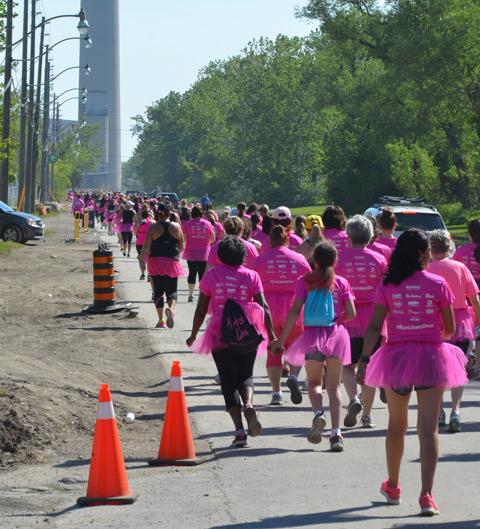 pink tshirts an dpink tutus, Run Like a Diva, runners running down Unwin street
