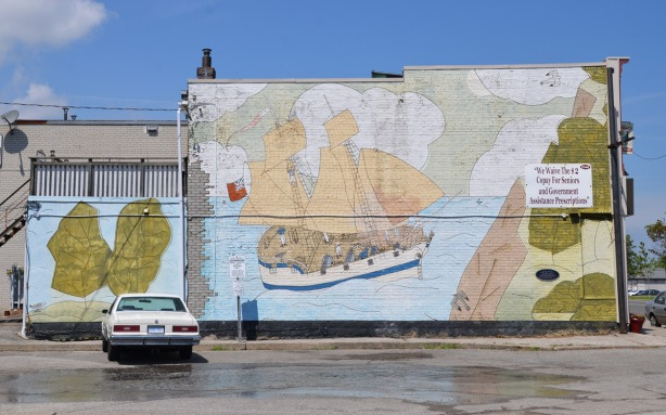 painted mural of a schooner from the 1790s sailing on Lake Ontario