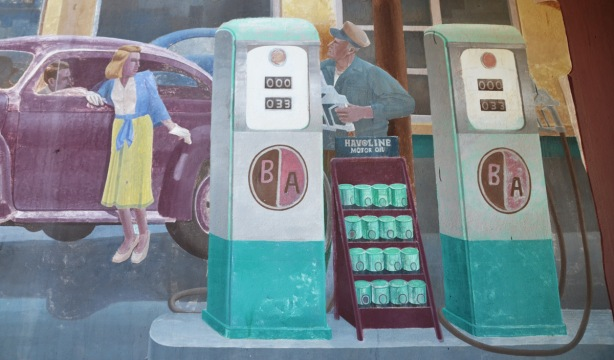part of a mural showing a gas station from the 1940s or 1950s