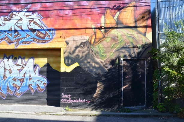 part of a mural with a stegasaurus dinosaur