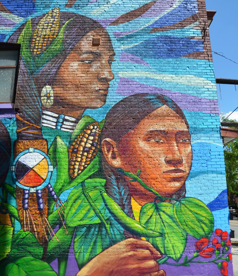 part of a larger mural by Tilay and Aner, two South American women with corn cobs in their hair and leaves around their neck