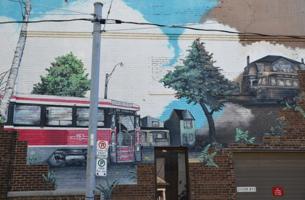 a mural of a ttc streetcar and a house