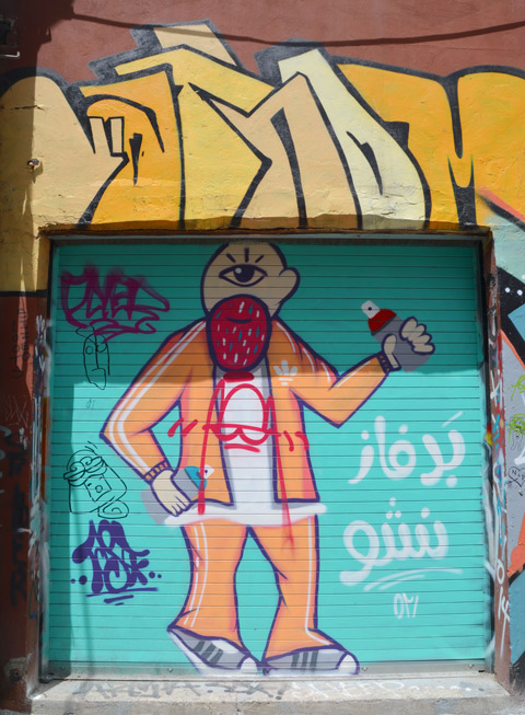 street art painting on a garage door, turquoise background, a man standing with a spray paint can in his hand, awkeardly drawn, simplistic, man with only one eye and a large beard that looks like a strawberry