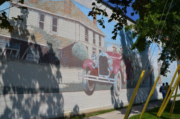 red vintage car in a mural