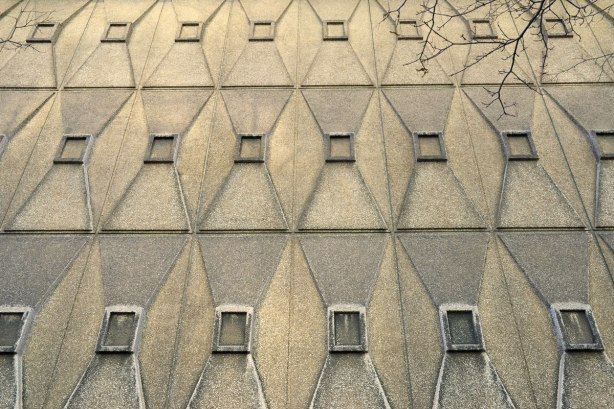 trapezoid sections on a concrete exterior wall