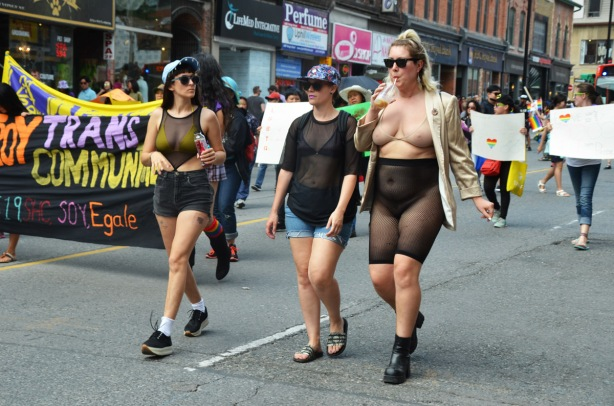 three women walking together in the dyke march