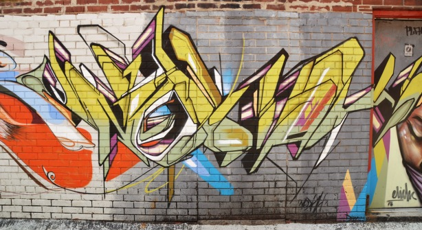 stylized throw up type graffiti