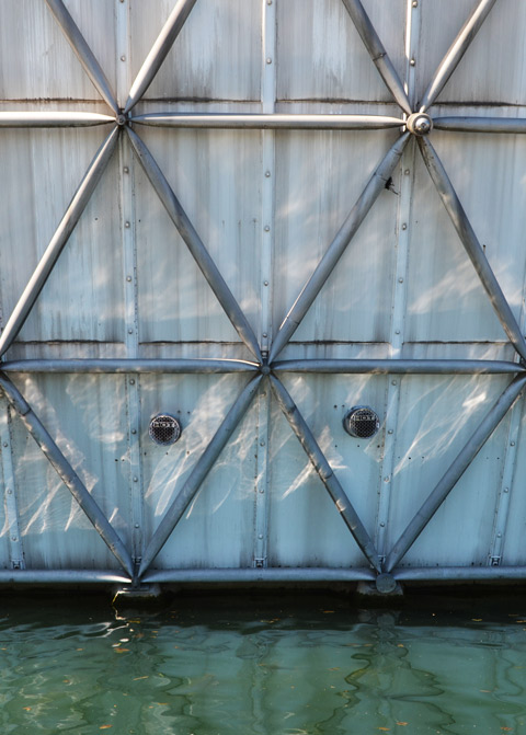 close up photo of a small part of the side of the cinesphere building, showing the metal bars that form the exoskeleton structure of the spherical building