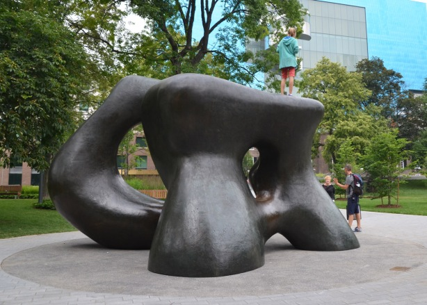 the Henry Moore sculpture in Grange Park behind the Art Gallery of Ontario - Large Two Forms, with the blue wall of the AGO in the background